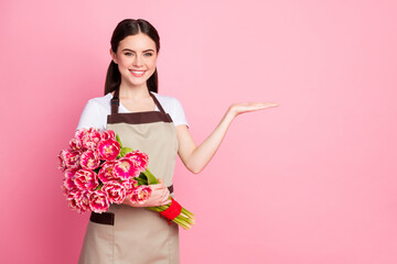 Portrait of her she nice-looking attractive lovely pretty confident cheerful cheery girl holding in hands bouquet copy space client care service isolated over pink pastel color background