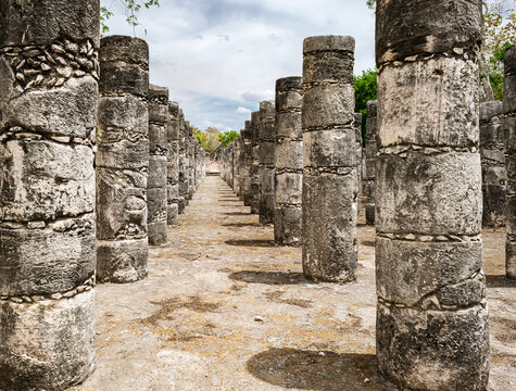 Thousand columns structure: Mayan ruins featuring carved pillars at Chichen Itza archaeological site.