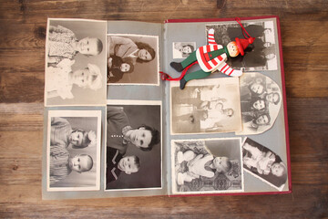 Wall Mural - old vintage monochrome photographs in sepia color are scattered on a wooden table, made in 1963 - 1964, concept of genealogy, memory of ancestors, family ties, memories of childhood