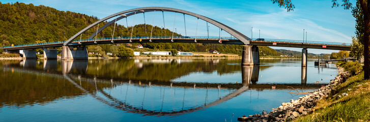 High resolution stitched panorama of a beautiful spring view with reflections and a bridge at Vilshofen, Danube, Bavaria, Germany