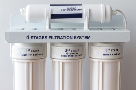 Four stages water filtration system for the home with: coconut postcarbon filter, granular activated and block carbon filters. Reverse osmosis system. Closeup view