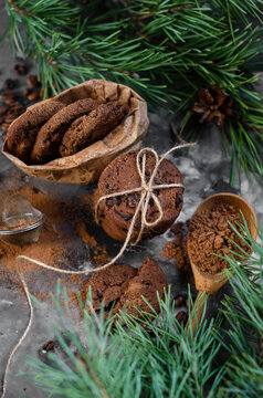 cookies with pieces of chocolate tied with a string on the background of fir branches. Christmas cookies