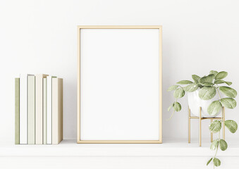 Photo Blinds Equestrian Poster mockup with vertical gold metal frame on the table with green plant in pot, books and trendy interior decoration on empty white wall background. A4, A3 size format. 3D rendering, illustration.