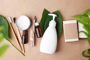Zero waste bathroom accessories, natural bamboo toothbrush, coconut solid soap and shampoo bars, reusable metal jar with toothpaste, concept of eco-friendly sustainable lifestyle, bathroom
