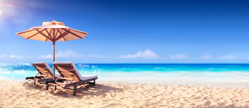 Two Chairs And Parasol With In The Golden Beach