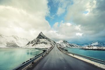 Olstind Mount and asphalt road. Lofoten islands, spring time, Norway