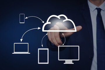 Modern storage technology concept. Man touching icon of cloud on virtual screen