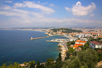Beautiful view of Nice harbor from Mont Boron. Also you can see the Promenade des Anglais, the marina, buildings and the Mediterranean Sea, Nice, French Riviera, Provence, Côte d'Azur, France.