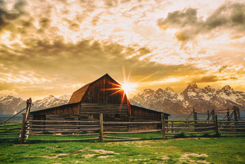 Mormon Row barn in Jackson Hole, Wyoming at sunset