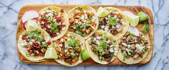 Wall Mural - wooden tray full of mexican street tacos