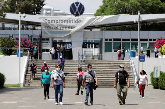 Volkswagen employees leave the plant after attending a training before the reopening of the automotive sector as the spread of the coronavirus disease (COVID-19) continues, in Puebla