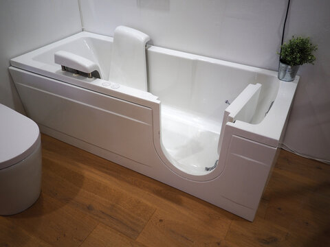 Handicapped disabled access bathroom bathtub with electric handles