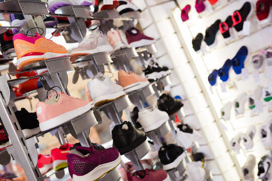 Collection of sneakers on shelves in store