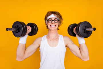 Close-up portrait of his he nice attractive funky cheerful cheery motivated guy sportsman lifting...