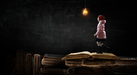 Girl walking with book around her