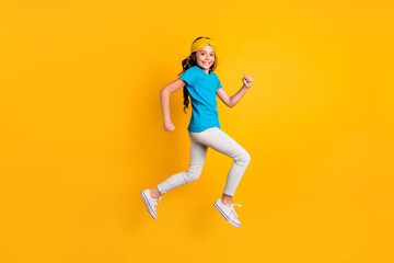 Full length profile photo of funny little lady walking down street jumping high good mood wear...