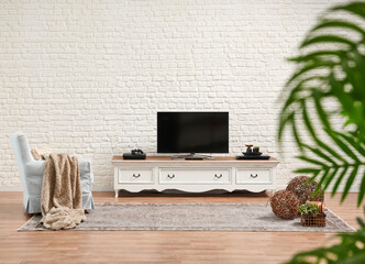 Decorative white classic television unit and brick wall background.