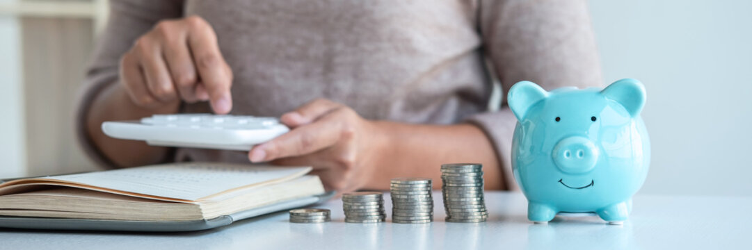 Young woman and piggy bank to planning growing saving strategy with pile coins