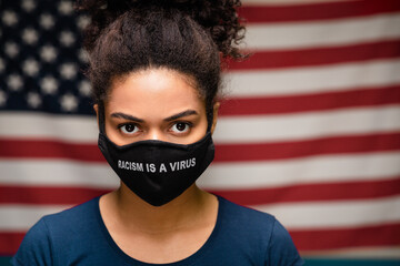 Black woman wearing protective mask text Racism is a Virus