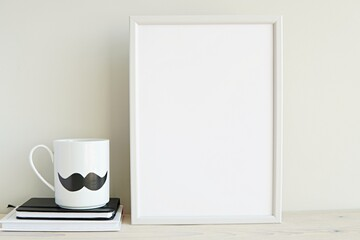 Vertical white frame mockup in monochrome men room for art, photo, lettering, quote, mug with mustache.