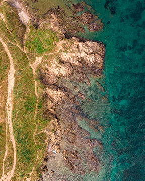 Cliffs and turquoise blue water in the coves of Argeles Sur Mer in the South of France. A photo taken with a drone, which gives this incredible sky view.
