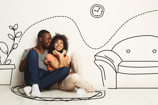 Black guy and his girlfriend imagining new furnished home against white wall with interior drawings