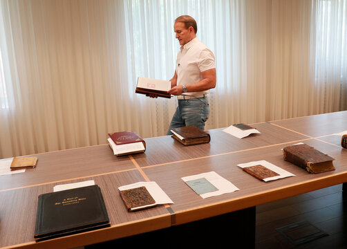 Ukrainian opposition politician Medvedchuk shows a book from his collection during an interview in Kyiv