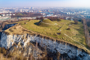 Fototapeta Krakus Mound, Kopiec Krakusa commemorating a legendary founder of Krakow. The origin of the mound, probably early medieval kurgan, is not known. Old quarry in front. City panorama in the background obraz