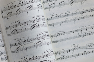 View of a book with turned page with music notes or notation