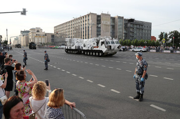 People take pictures of a Pantsir antiaircraft missile system before a rehearsal for the Victory Day parade in Moscow
