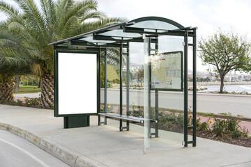 Blank white, vertical mockup of bus stop billboard in empty Caddebostan street