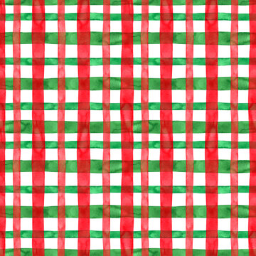 Tartan plaid seamless pattern with watercolor stripes and squares on white background. Christmas and New Year style print in classic red and green colors. hand painted illustration
