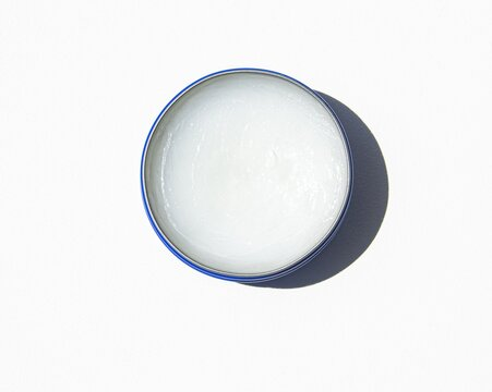 Petroleum jelly in a blue jar for skin moisture and healing.
