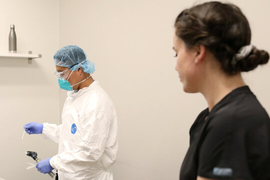 People line up to be tested for coronavirus disease in Phoenix