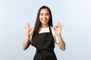 Coffee shop, small business and startup concept. Smiling attractive korean female barista, waitress...