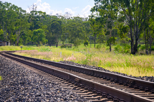 Rail tracks in Queensland countryside during summer