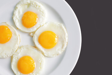 Four fried eggs for healthy breakfast. top view