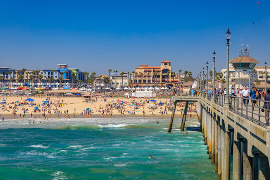 View of the pier, ocean and beach in surf city Huntington Beach, famous tourist destination in California