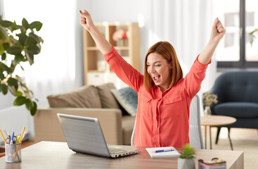 remote job, technology and people concept - happy smiling young woman with laptop computer working...