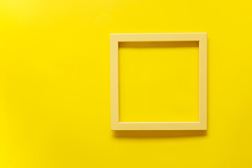 Yellow vintage frame on yellow background. Top view, blank space