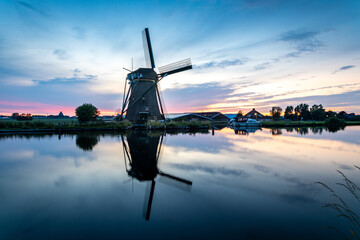 The historic Lisserpoel windmill in the evening. On the Ringvaart river in Lisse, the Netherlands.