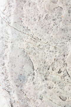 Old vintage light grey texture of stone or marble. Macro