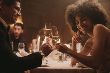 Couple having drinks at a dinner party