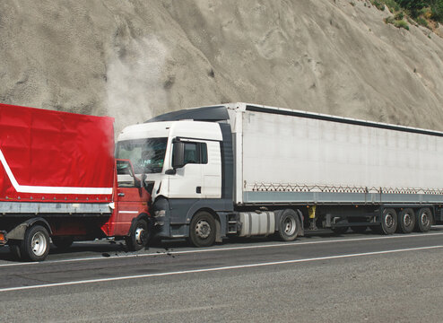 Road accident. Two trucks collided head-on. Trucks carrying goods involved in the accident