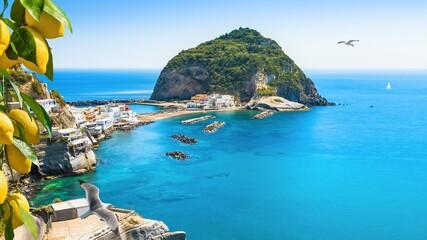 Foto op Canvas Cappuccino Rocky coast of Sant'Angelo, giant green rock in blue sea near Ischia Island, Italy. Sant'Angelo is small village within comune of Serrara Fontana, Ischia.
