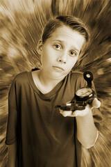 Boy with compass inquiring look monochrome