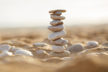 Foto op Plexiglas Stenen in het Zand sea stones tower on sand. summer and sunset on sea background. relaxation and meditation on beach