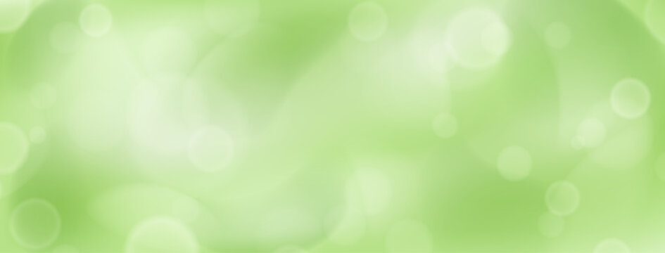 Abstract background with bokeh effects in green colors