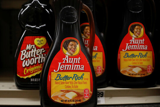 Bottles of Mrs. Butter-Worth's branded syrup are seen along side Aunt Jemima branded syrup on a store shelf in the Brooklyn borough of New York
