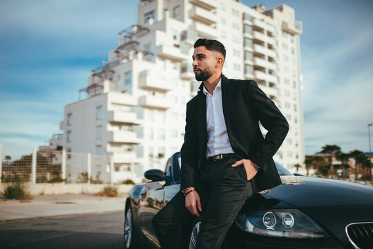 Side view of Attractive businessman with convertible car
